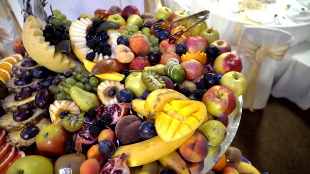 fresh fruit served on buffet table - buffet video stock e b–roll