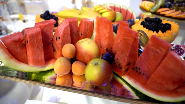 Fresh Fruit Served on Buffet Table Different kind of fresh fruits served on table on the party. plum stock videos & royalty-free footage