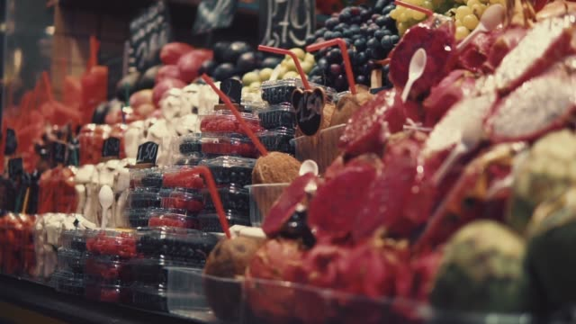 fresh fruits and berries are standing on showcase in traditional market, close-up - souk video stock e b–roll