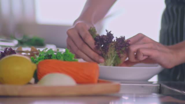 Fresh green salad in the beautiful morning light. Food Decor tomato salad stock videos & royalty-free footage