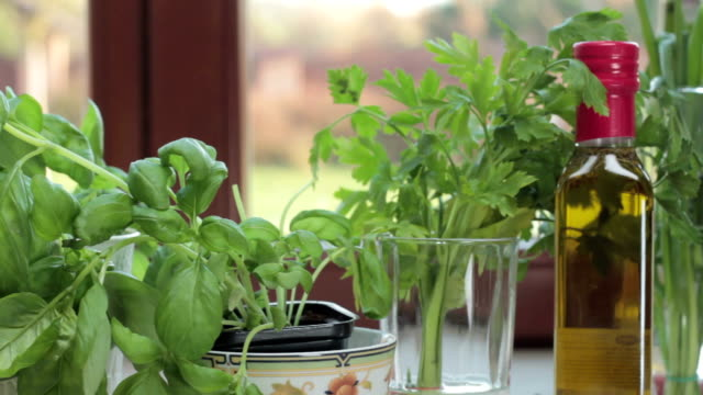 Fresh herbs in the kitchen, tracking shot Fresh herbs in the kitchen, tracking shot parsley stock videos & royalty-free footage