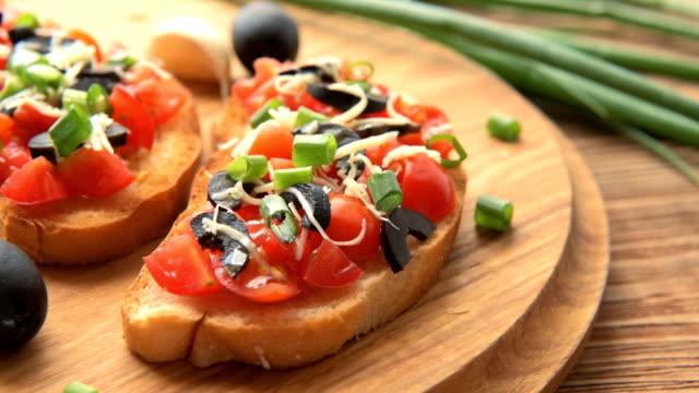 Fresh homemade crispy Italian Bruschetta with tomato, garlic and basil video