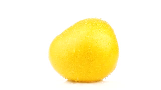 Fresh Juice Mango with water Juice of yellow Mango fruit with water dew on white background mango stock videos & royalty-free footage