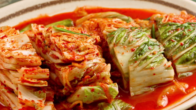 Fresh Kimchi close up Fresh Kimchi made of Napa Cabbage cabbage stock videos & royalty-free footage