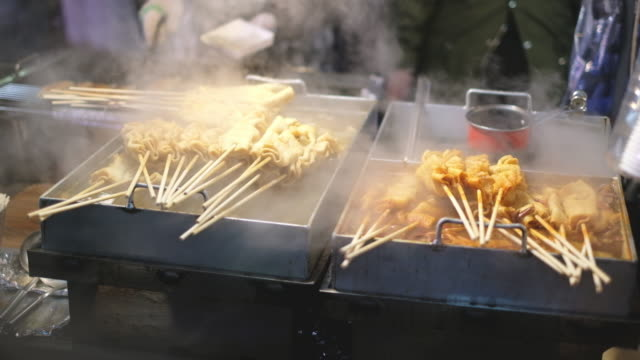 fresh korean street food at night market - spiedino video stock e b–roll