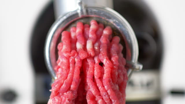 Fresh Meat Coming 0ut Of A Mincer Close-up shot made in 4K/Ultra High Definition. True 4:2:2 at 10bit ground beef stock videos & royalty-free footage