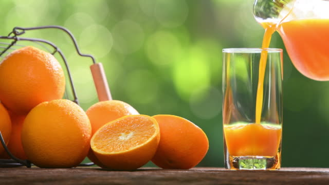 Fresh orange juice pouring into glass Fresh orange juice pouring into glass orange juice stock videos & royalty-free footage