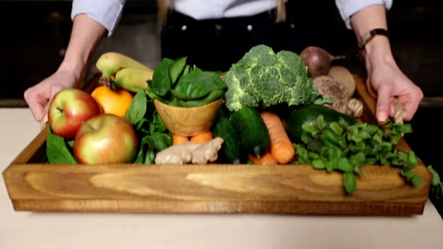 Fresh organic fruits and vegetables in wooden tray video