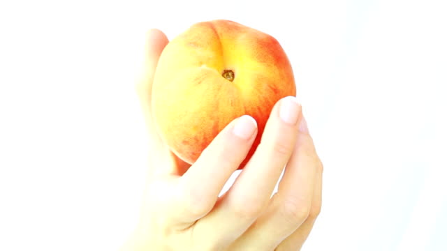 Fresh peach in woman's hands.Close up. video