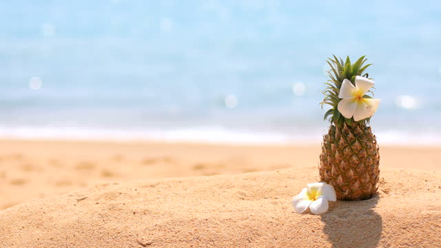 Fresh pineapple on tropical beach.