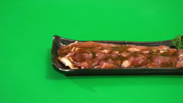 fresh pork sliced - white background стоковые видео и кадры b-roll