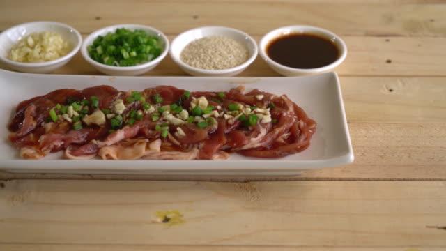 fresh pork sliced with ingredients video
