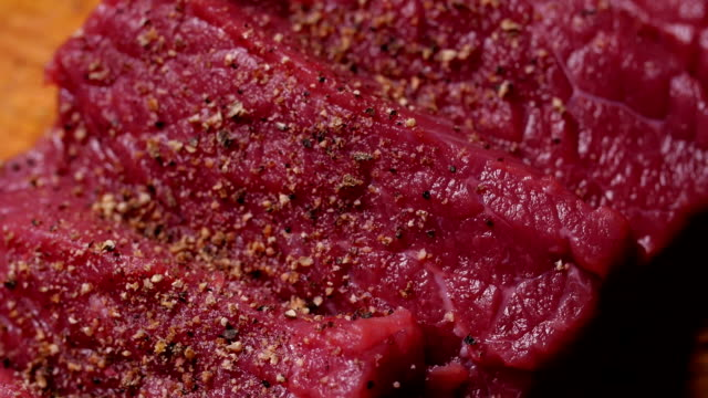 fresh raw meat for steak on wooden cutting board video