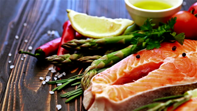 Fresh Raw Salmon Red Fish Steak Fresh Raw Salmon Red Fish Steak on wooden background ingredient stock videos & royalty-free footage