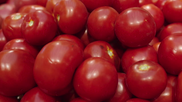 Fresh Raw tomatoes in a counter of market