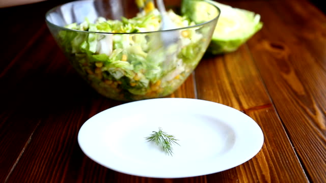 fresh salad of young cabbage with sweet corn fresh salad of young cabbage with sweet corn on a wooden table salad bowl stock videos & royalty-free footage