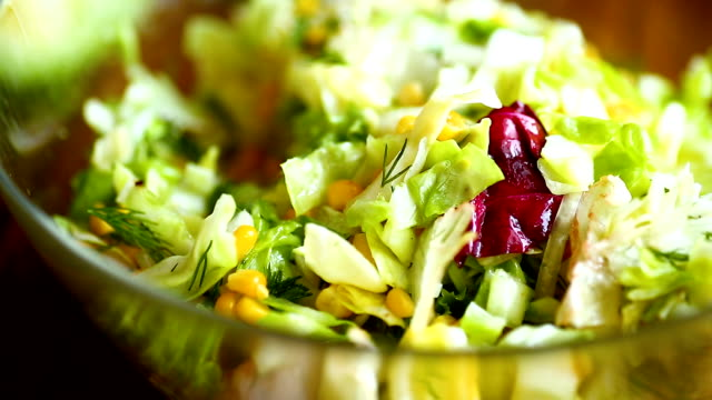 fresh salad of young cabbage with sweet corn fresh salad of young cabbage with sweet corn on a wooden table cabbage stock videos & royalty-free footage