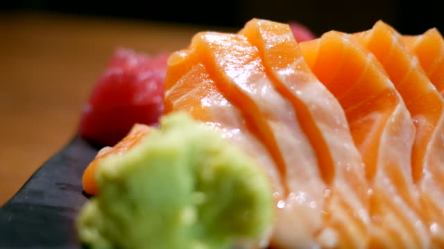 fresh salmon on table in motion - sashimi video stock e b–roll