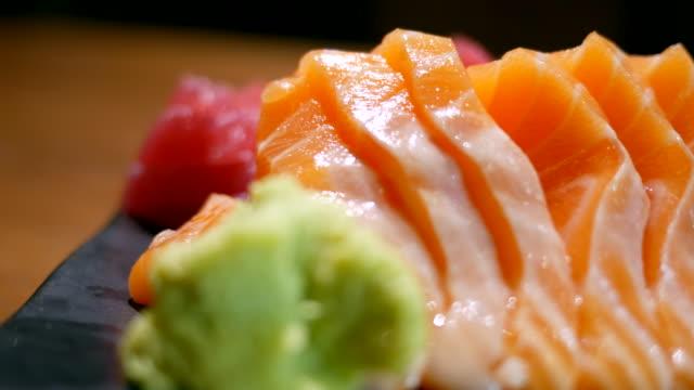 Fresh Salmon on table in motion 3840x2160,UHD,4K sashimi stock videos & royalty-free footage