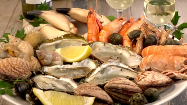 fresh seafood platter with lobster mussels and oysters on turn table - seafood stock videos and b-roll footage