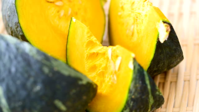 fresh sliced pumpkin close up - zucchini video stock e b–roll