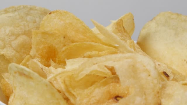 fresh slices of fried potato chips for youth in a bowl popular appetizer 4k - smażony ziemniak filmów i materiałów b-roll