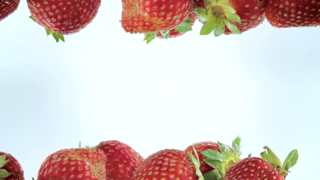 Fresh strawberry dropped into water video