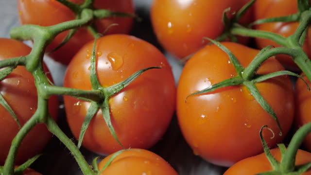 Fresh tomatoes rotate on a marble stand. Counterclockwise rotation. View from above. tomato salad stock videos & royalty-free footage
