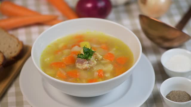 Fresh Vegetable soup in a white bowl , Traveling