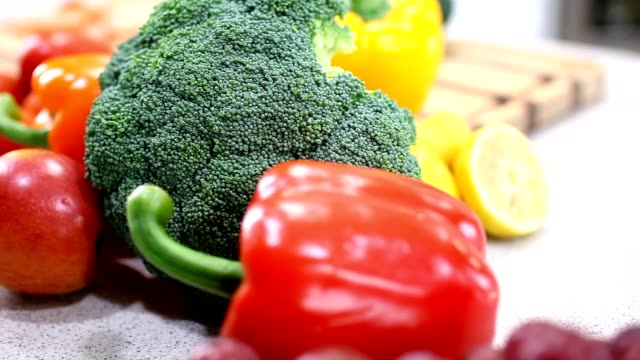 Fresh vegetables and fruit on kitchen counter. video