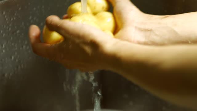 Fresh vegetables in kitchen sink. video