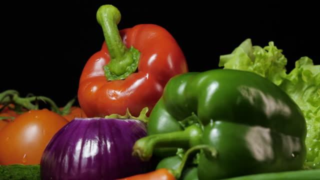 Fresh vegetables on a dark background.