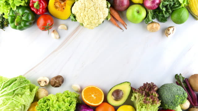 Fresh vegetables on marble background, stop motion