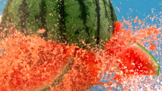 Fresh Watermelon Fruit Juice splashing out. Watermelon slices with juice splashes. watermelon stock videos & royalty-free footage