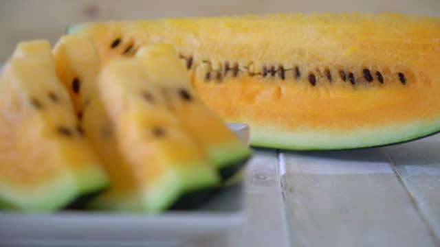 fresh yellow watermelon - white background стоковые видео и кадры b-roll