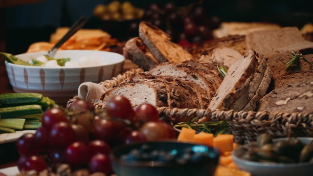 Freshly baked whole grain bread on the breakfast table. video