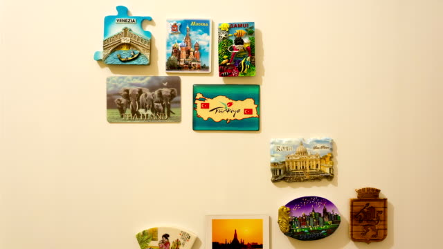 fridge magnets, travel magnets time lapse hands place many magnets on refrigerator in time lapse, stop motion magnet stock videos & royalty-free footage