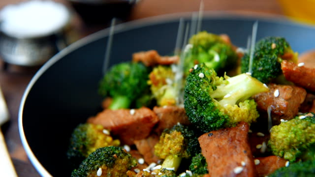 Friead broccoli and beef in pan Friead broccoli and beef in black frying pan recipe stock videos & royalty-free footage