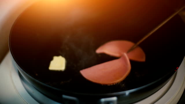 Fried bologna in frying pan for making a sandwich. video