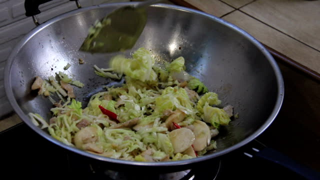 fried cabbage with pork slice in pan video