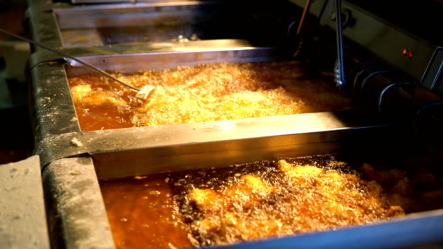 Fried Chicken Being Cooked in Oil Vat video