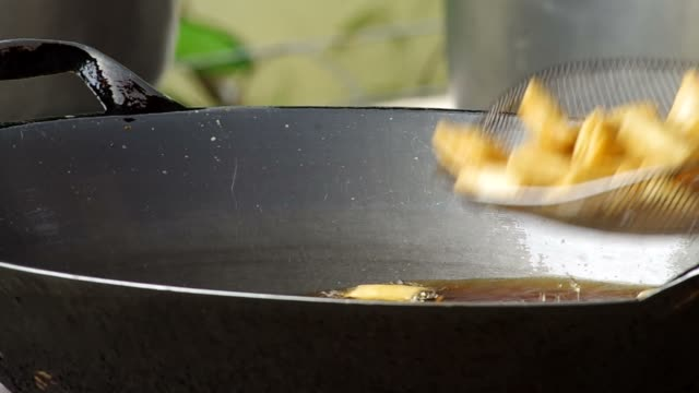 fried food and cooking sieve used video