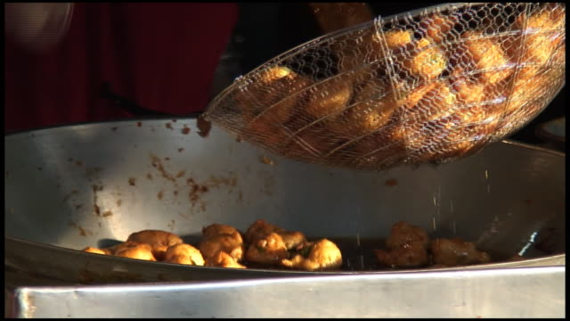 (HD1080) Fried Food Balls Being Scooped Out of Pan (HD1080) Fried Food Balls Being Scooped Out of Pan.  HD 16:9 NTSC 1920 x 1080 with 30 fps. Natural background audio. This high quality digital file can be imported and edited in standard definition NTSC or PAL editing programs. (HD0xx).     See similar video clips at http://www.istockphoto.com/korudirect. stir fried stock videos & royalty-free footage