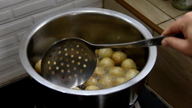 fried pork ball on hot oil video