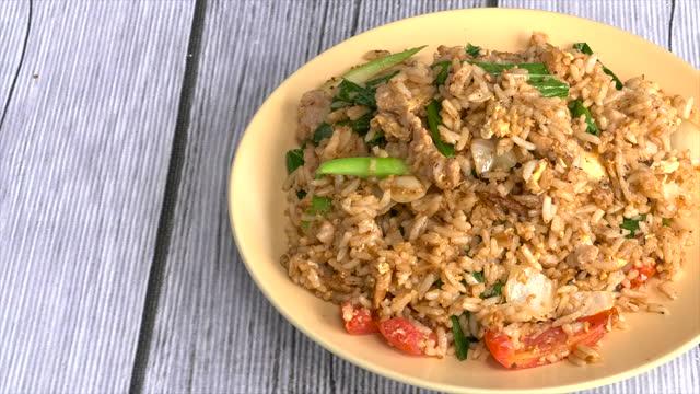 Fried rice with pork Fried rice with pork pork stock videos & royalty-free footage