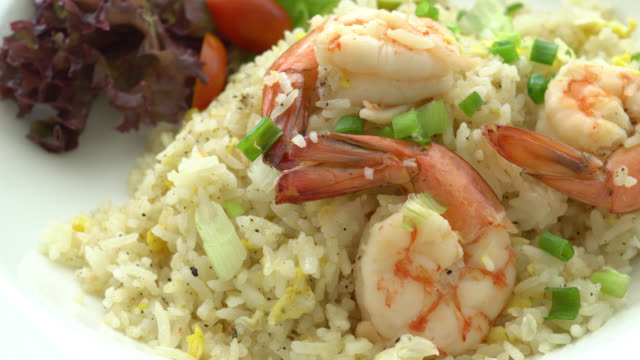 Fried rice with shrimp on top video