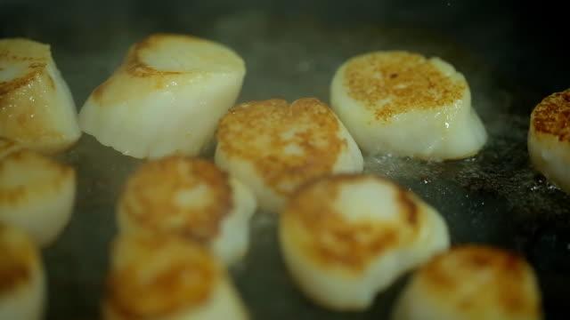 fried scallops in a frying pan video