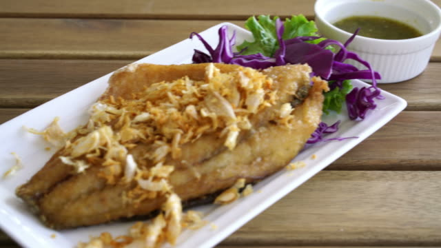 Fried Snapper Fish Fillet with Garlic Fried Snapper Fish Fillet with Garlic fillet stock videos & royalty-free footage
