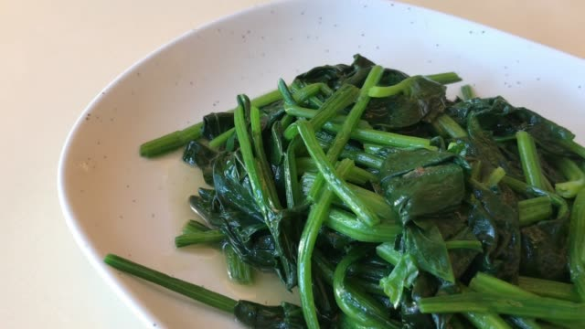 fried spinach on plate fried spinach on plate cooked stock videos & royalty-free footage