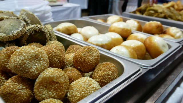 Fried sweet balls with sesame. video